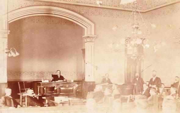 This is how the Court Room looked when the Courthouse was built.  Notice the old light fixtures and all the stenciling work.