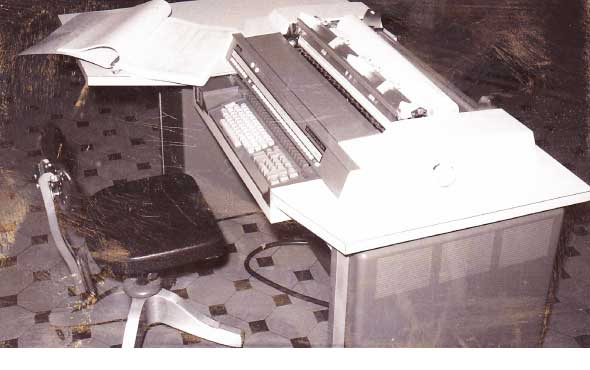 County's first computer.  To run a program you had to feed a paper tape into it to load the software and the data was stored on punch cards.